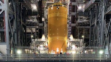 See NASA's bonkers-big moon rocket standing up, boosters and all