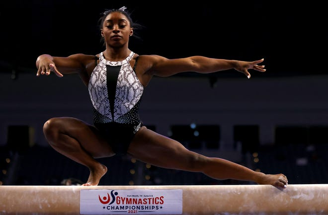 Simone Biles warms up on the beam during the U.S. Gymnastics Championships at Dickies Arena in Fort Worth, Texas.