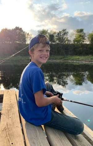 Ricky Lee Sneve, 10, died after rescuing his sister in the water. He loved fishing.