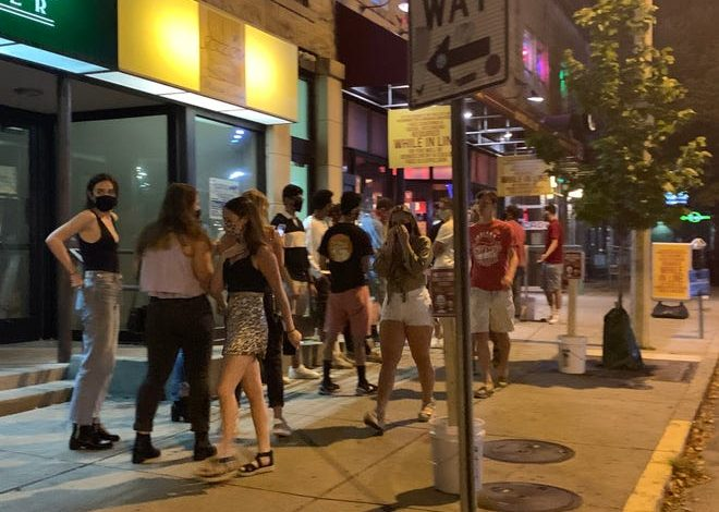 Students gather outside Brothers Bar and Grill near the Indiana University campus in Bloomington, Ind., on Sept. 3, 2020.