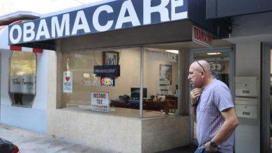 A. Michael Khoury stands outside of his Leading Insurance Agency, which offers plans under the Affordable Care Act (also known as Obamacare) on January 28, 2021 in Miami, Florida. President Joe Biden signed an executive order to reopen the Affordable Care Act's federal insurance marketplaces from February 15 to May 15.
