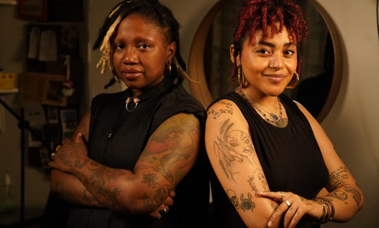Tann Parker, left, founder of Ink the Diaspora, and tattoo artist Quiara Capellan in their studio in Brooklyn, New York. Parker created the platform Ink the Diaspora in 2017 to inspire people of color to get the tattoos they want and help connect people with artists of color.