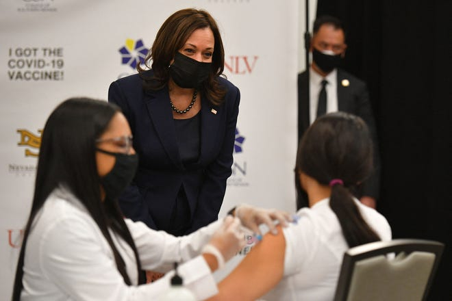 US Vice President Kamala Harris watches a health worker giving a Covid-19 vaccine to a woman at the University of Nevada in Las Vegas on March 15, 2021. - Vice President Kamala Harris is visiting Las Vegas Monday to promote the $1.9 trillion Ccovid relief package, known as the American Rescue Plan.