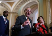 Senate Majority Leader Chuck Schumer, D-N.Y., flanked by Sen. Raphael Warnock, D-Ga., left, and Sen. Amy Klobuchar, D-Minn., speaks with reporters before a key test vote on the For the People Act.