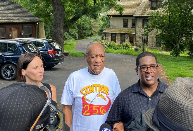Bill Cosby flanked by his attorney Jennifer Bonjean and spokesman Andrew Wyatt speak outside of Cosby's home in Cheltenham, Pa., on June 30, 2021.