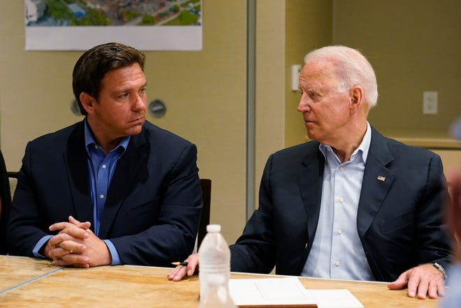 President Joe Biden, right, looks at Florida Gov. Ron DeSantis, left, during a briefing with first responders and local officials in Miami on July 1, 2021, on the condo tower that collapsed in Surfside, Fla., last week.