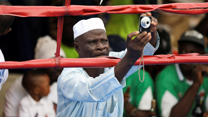 A man uses a digital camera to take pictures during a youth boxing tournament in Iyana-ipaja, Lagos, Nigeria - Saturday 26 June 2021