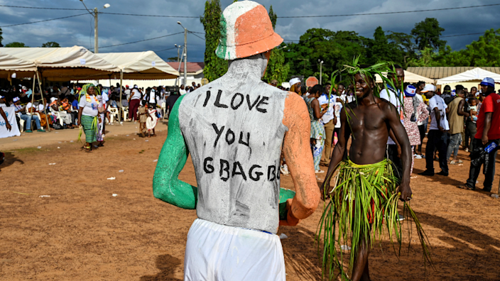 """A man with """"I Love Gbagbo"""" painted on his back in Mama, Ivory Coast - Sunday 27 June 2021"""