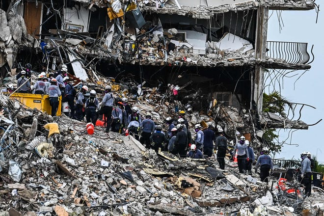 Rescuers look for possible survivors in the partially collapsed condo building in Surfside, Fla., on June 29, 2021.