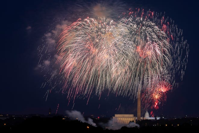 Fourth of July fireworks explode over the Lincoln Memorial, the Washington Monument and the U.S. Capitol along the National Mall in Washington.