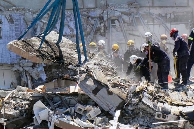 Crews work in the rubble at the Champlain Towers South Condo, Sunday, June 27, 2021, in Surfside, Fla.