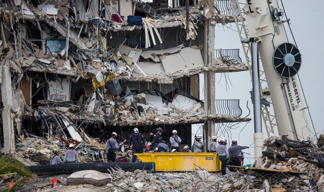 Rescuers continue to search through the rubble  of the Champlain Towers south condo collapse in Surfside, Florida on Tuesday, June 29, 2021.