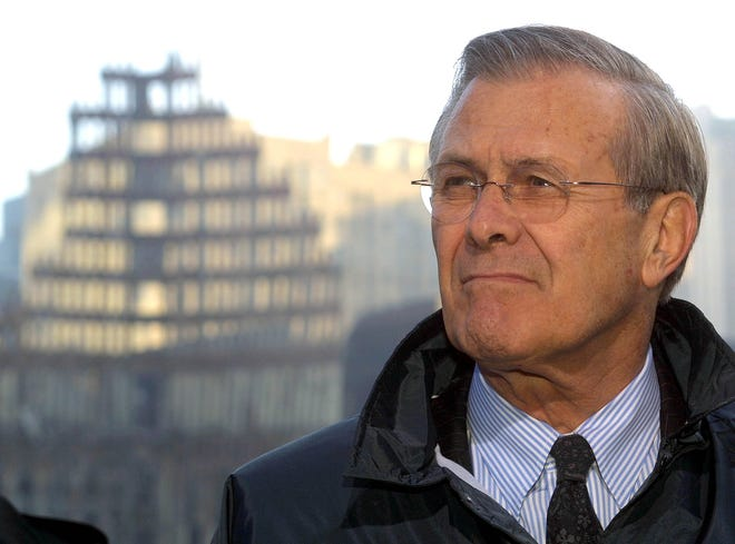 Secretary of Defense Donald Rumsfeld listens to reporters' questions at Ground Zero of the World Trade Center site in New York on Nov. 14, 2001.