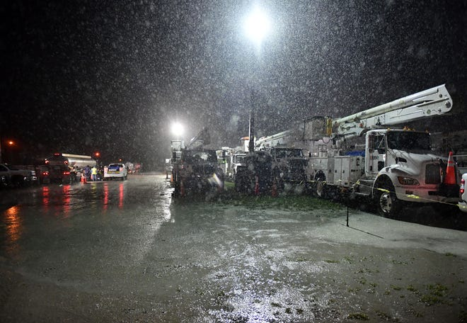 Power company crews from across the state and out of state are staging at the Sarasota Fairgrounds, in Sarasota, Florida on Tuesday night, July 6, 2021.