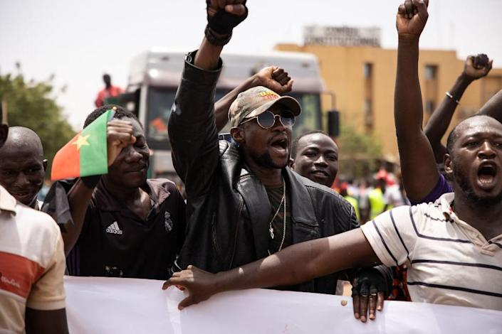 People take part in a march called by the opposition to protest against the security situation worsening and asking for a response to jihadist attacks, in Ouagadougou, on July 3, 2021.