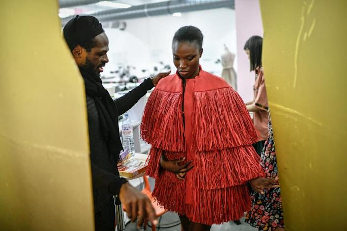 Cameroonian fashion designer Imane Ayissi supervises a model during the shooting of the video presentation of his Haute Couture Fall Winter 2021-2022 collection, in Paris, on July 3, 2021.