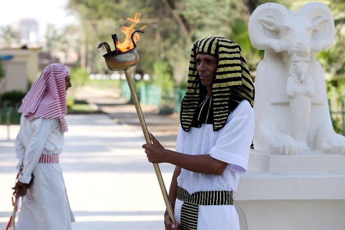 Actors wearing Pharaonic costumes perform during a Pharaonic Wedding, a new tourist attraction at the Pharaonic Village in Giza, Egypt, 05 July 2021.