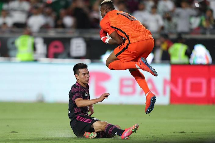Goalkeeper Chinonso Eziekwe #18 of Nigeria and Hirving Lozano #22 of Mexico fight the ball during the friendly match between Mexico and Nigeria at Los Angeles Memorial Coliseum on July 3, 2021 in Los Angeles, California