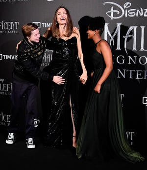 """Angelina Jolie poses with her kids Shiloh, left, and Zahara during the Rome premiere of """"Maleficent: Mistress of Evil"""" in October 2019."""