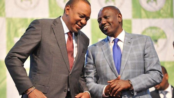 Kenya's president-elect, Uhuru Kenyatta (L) with his running mate William Ruto wait to receive their certificates of election October 30, 2017 after they were announced winners of a repeat presidential poll by the Independent Electoral and Boundaries Commission chairman