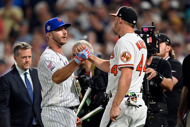 Pete Alonso greets Trey Mancini after the Home Run Derby.