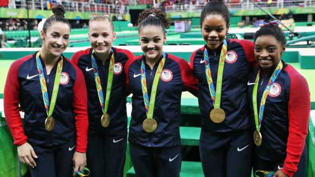 Alexandra Raisman, Madison Kocian, Lauren Hernandez, Gabrielle Douglas and Simone Biles of the USA pose with their gold medals after winning the Women's Team Final of the Rio 2016 Olympic Games Artistic Gymnastics events at the Rio Olympic Arena in Barra da Tijuca, Rio de Janeiro, Brazil, 09 August 2016.