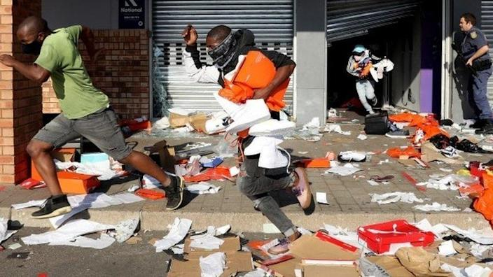 Looters empty a store of goods in the Springfield Value Centre during protest in, Durban, South Africa, 12 July 2021