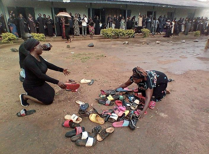 Parents of students abducted at Bethel Baptist High School pray for their safe return around discarded shoes left behind by the children, in Kaduna, Nigeria July 9, 2021.