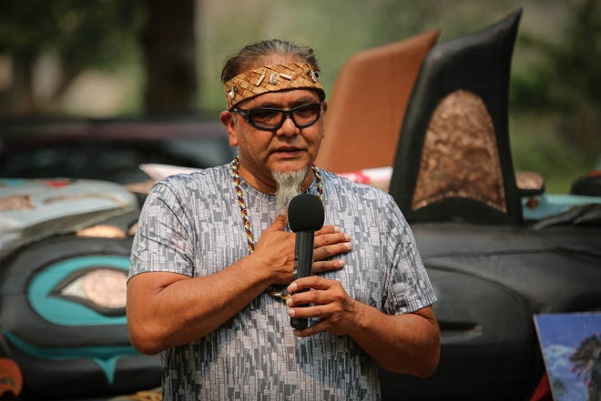 Lummi totem carver Phreddie Lane speaks on July 15 at the Snake River Canyon stop in Idaho of the Red Road to D.C. tour, which finds dozens of Native American activists driving cross-country with the 25-foot tall totem to highlight the needs to protect sacred places.