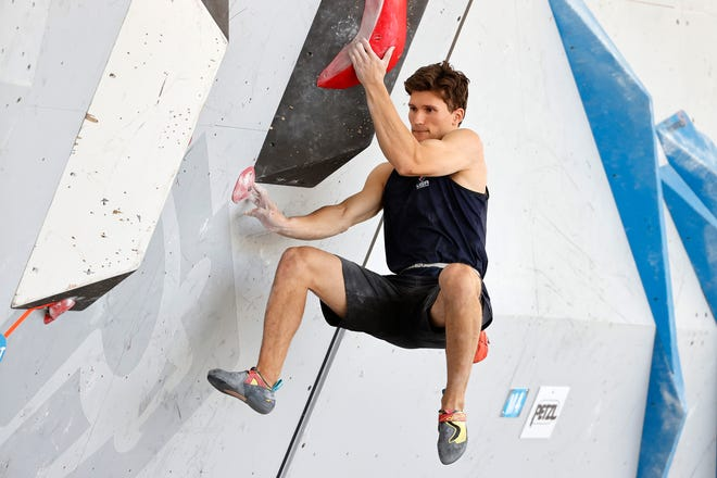 Nathaniel Coleman competes in a qualification round during the FIS Climbing World Cup Bouldering competition in Salt Lake City in 2021.