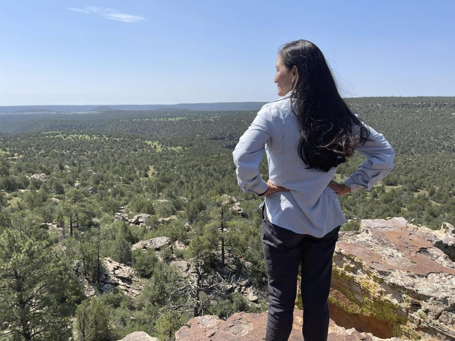 U.S. Interior Secretary Deb Haaland looks out at the Sabinoso Wilderness in Las Vegas, N.M., after accepting a land donation from the Trust for Public Land to the Bureau of Land Management. The donation increases the size of the Sabinoso Wilderness in northeastern New Mexico by nearly 50%.