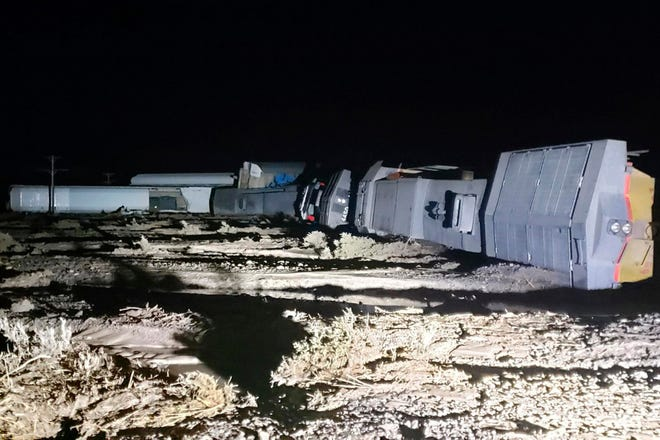 Three workers on a freight train were injured when it derailed while crossing tracks covered with water in a remote part of southern Utah. The train, which had nearly 100 cars, tipped on its side after derailing near Lund, about 85 miles from the Nevada border.