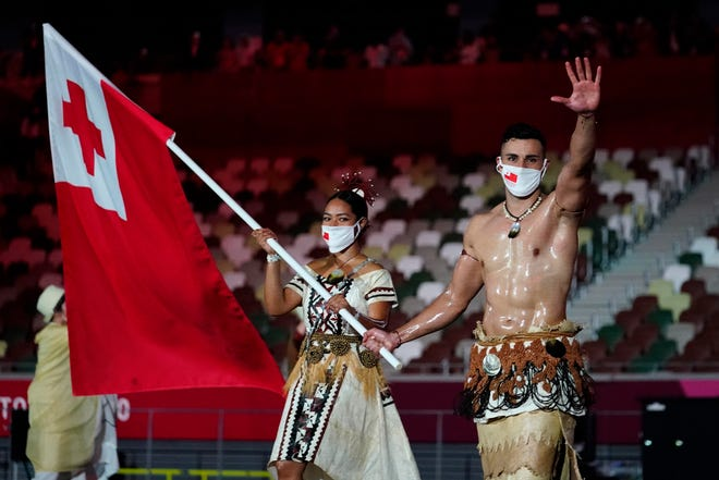 Tonga flag bearers Malia Paseka and Pita Taufatofua during the opening ceremony for the Tokyo 2020 Olympic Summer Games.