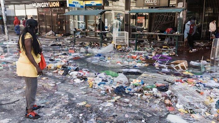 Dr. Pixley Ka Seme street is strewn with dirt and filth caused after five days of looting in Durban on July 14, 2021 as several shops, businesses and infrastructure are damaged in the city, following five nights of continued violence and looting sparked by the jailing of ex-president Jacob Zuma