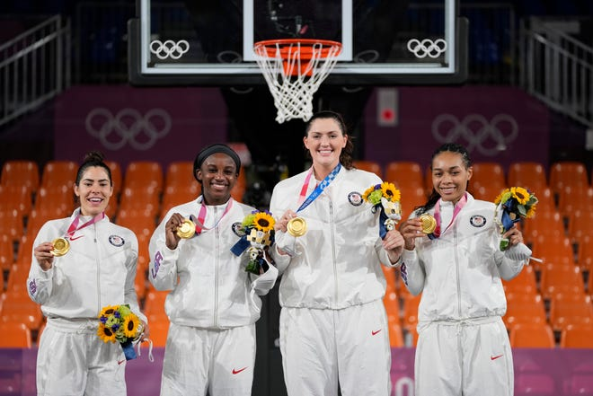 Members of team United States, from left to right, Kelsey Plum, Jackie Young, Stefanie Dolson and Allisha Gray pose with their gold medals during the awards ceremony for women's 3-on-3 basketball at the Tokyo Summer Olympics.