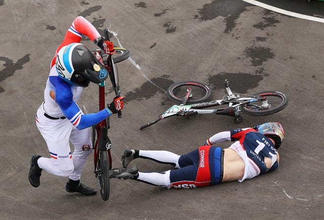 Connor Fields, right, crashed after a collision with France's Romain Mahieu during the Men's BMX semifinal at Ariake Urban Sports Park.