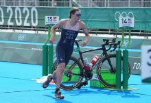 Katie Zaferes makes the transition from biking to running in the women's triathlon at Odaiba Marine Park.