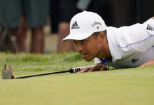 Xander Schauffele lies down to read the second green in the third round.