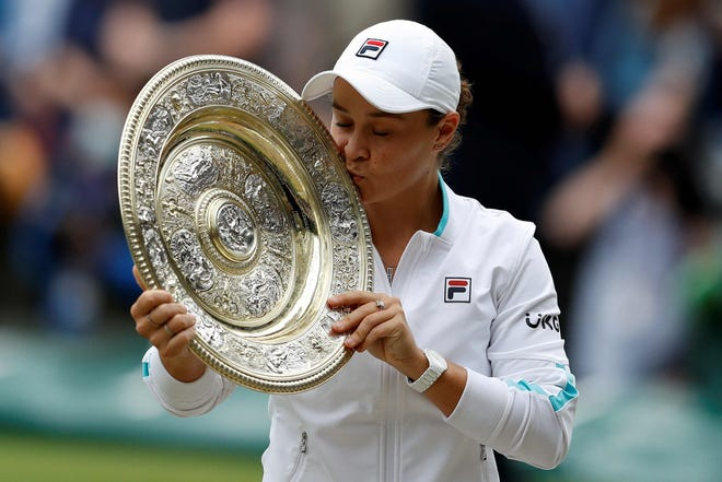 Barty celebrates with the trophy after winning the Wimbledon final.