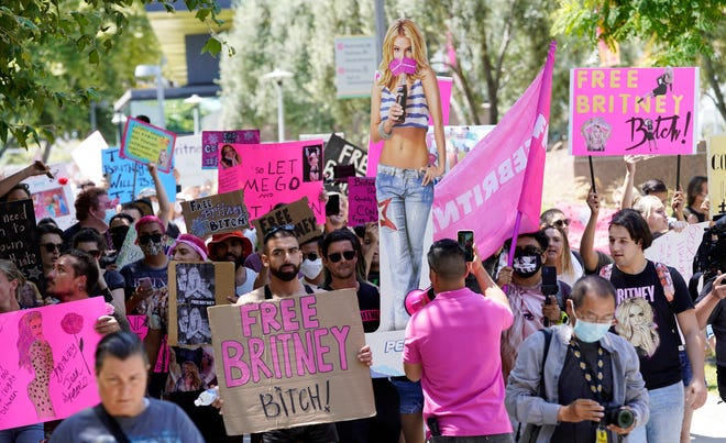 Britney Spears supporters march outside a court hearing concerning the pop singer's conservatorship at the Stanley Mosk Courthouse, Wednesday, June 23, 2021, in Los Angeles. Spears appeared in court on Wednesday to lobby against being under her current conservator, under her father Jamie Spears.