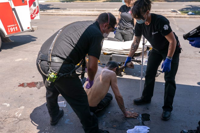 Treating a man experiencing heat exposure at a cooling center on June 26, 2021, in Salem, Ore.