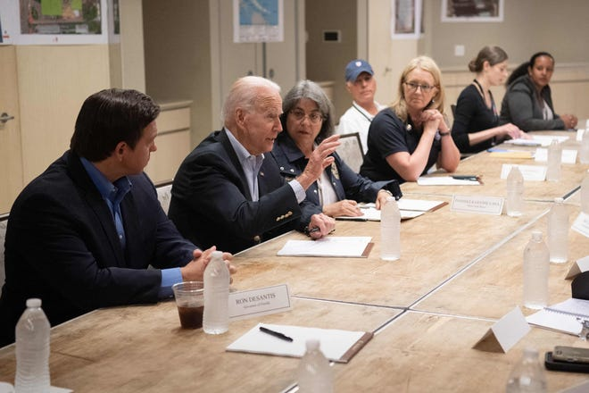 President Joe Biden speaks alongside Miami-Dade County Mayor Daniella Levine Cava, center, and Florida Gov. Ron DeSantis, left, about the collapse of the 12-story Champlain Towers South condo building in Surfside, during a briefing in Miami Beach, Florida on July 1, 2021.