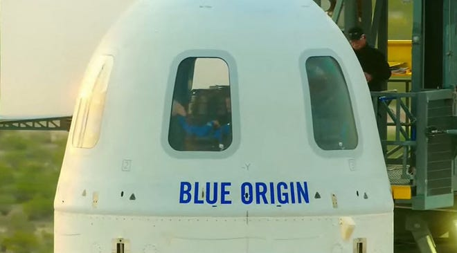 This still image taken from video by Blue Origin shows  Mark Bezos, Jeff Bezos,  Wally Funk and Oliver Daemen inside the capsule as they travel for the first crewed flight of Blue Origin's reusable New Shepard craft, on July 20, 2021, in Van Horn, Texas.