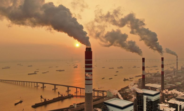 China, moving cautiously, starts carbon trading market