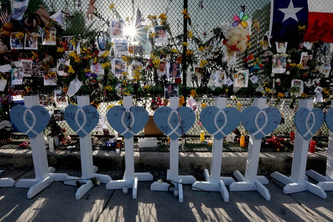 Wooden hearts are labeled with the names of some of those who were lost in the Champlain Towers South condo collapse in Surfside Fla.