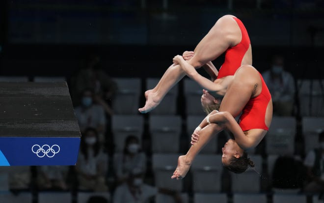 Jessica Parratto and Delaney Schnell compete in the women's 10-meter platform synchronized diving competition at Tokyo Aquatics Centre.