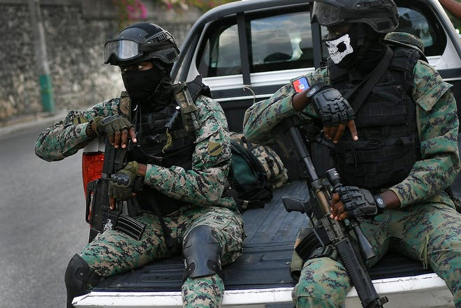 Soldiers stand guard near the residence of Interim President Claude Joseph in Port-au-Prince, Haiti, on July 11, 2021.