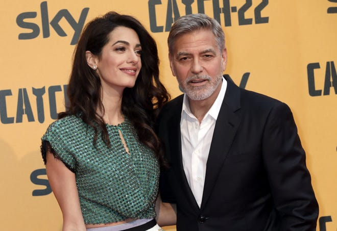 """George Clooney and wife Amal Clooney attend 2019's """"Catch-22"""" event in Rome. Clooney and other actors and producers are teaming up with Los Angeles Unified to launch a new school."""