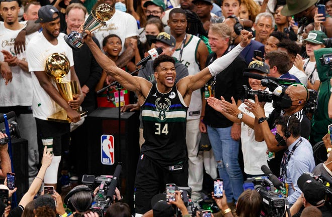 Giannis Antetokounmpo leads the celebration after the Bucks clinched the NBA title.
