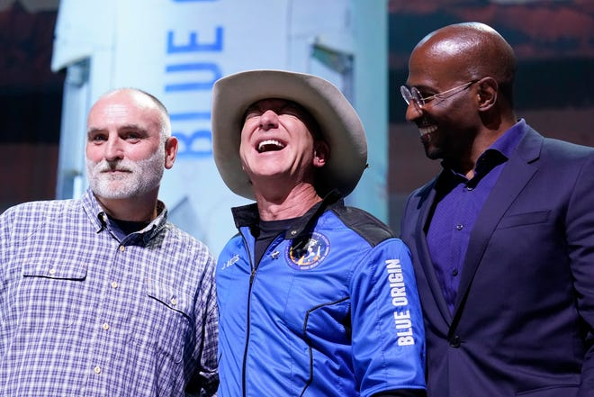 Jeff Bezos, center, founder of Amazon and space tourism company Blue Origin, poses for photos with Chef José Andrés, left, and Van Jones, right, founder of Dream Corps, during a briefing following the launch of the New Shepard rocket from its spaceport near Van Horn, Texas, Tuesday, July 20, 2021.